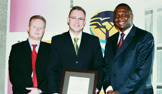 John Herbst (centre), MD of Pam Golding Properties Empowerment Division, receives the Recognition Award from Rali Mampeule (right), chairman of the Rali Mampeule Foundation and executive chairman of Phadima Group Holdings. On the left is Sean O'Sullivan, head of sales, FNB Homeloans.